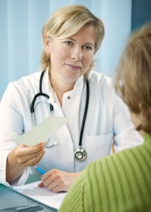 Doctor gives the patient a prescription or referral