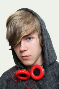 Serious Teenage  Boy wearing headphones