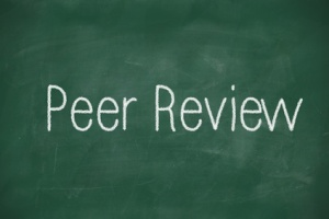 Peer Review written in white chalk