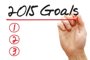 Hand underlining 2015 Goals with red marker, business concept