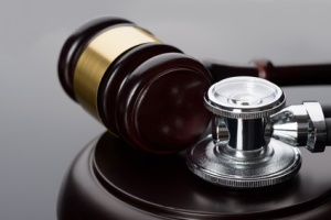 Close-up Of Brown Gavel And Medical Stethoscope